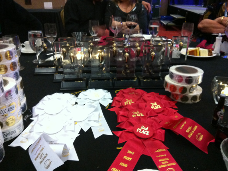 All of CaJohns\' awards: Golden Chiles, Second Place and Third Place awards.  Photo by Ken Alexander.