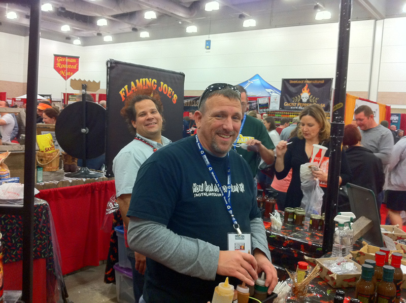 Tracy Carter of JAC\'s Tailgaters helps out at the Flaming Joe\'s booth.