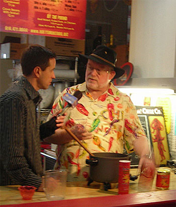 Johnny DiLoretto interviewing John 'CaJohn' Hard at CaJohn's CaBoom! Chili Company eatery in Columbus' North Market. Also located in the North Market is CaJohn's Flavor & Fire hot sauce stand.