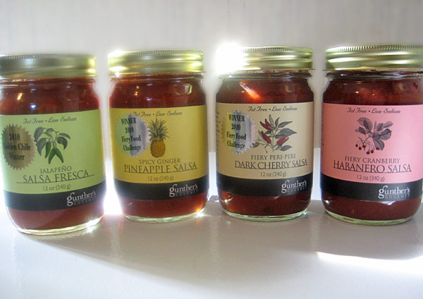 Gunther Gourmet's Jalapeño Salsa Fresca, Spicy Ginger Pineapple Salsa, Fiery Peri-Peri Dark Cherry Salsa, and Fiery Cranberry Habanero Salsa