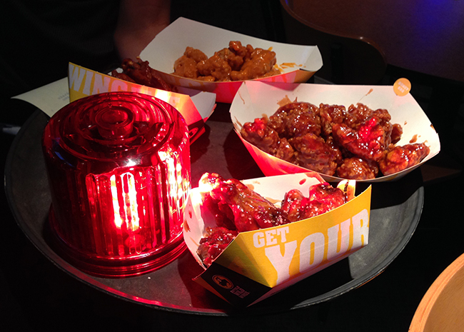 buffalo-wild-wings-new-sauces-ghost-pepper-sauce-salted-caramel-bbq-sauce with lights and siren